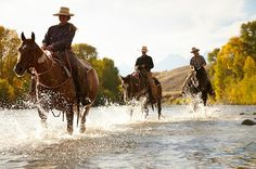 Crossing water on horseback with Gros Ventre River Ranch in Wyoming