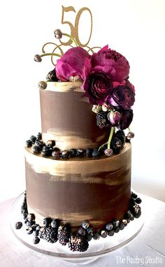 Two tiered chocolate designer cake by the pastry studio, a specialty bakery in Daytona Beach, Florida