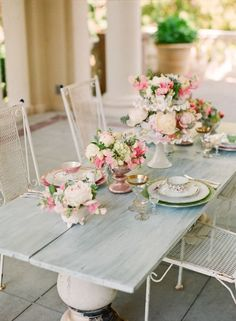 Love the rustic-ish looking table contrasted with the prim and proper decor
