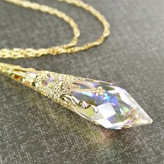 Clear crystal necklace antique gold brass swarovski clear crystal clear crystal necklace antique gold brass swarovski clear crystal pendant necklace aurora borealis necklace prism icicle april birthstone my style aloadofball Gallery