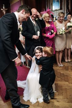 Child gives bride a big hug at the alter | 7 Top Wedding Day Tips for the Camera Shy Couple | Jim Whitham Photography | Visit www.weddingsite.co.uk for more inspiration