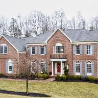 One acre wooded estate home with exquisite appointments including a two story foyer with turned staircase, decorative mouldings, gourmet kitchen with oversized island, 2nd private staircase, Family Room with a wall of windows, Master Bedroom with 2 walk in closets and sitting/study, Private level also includes 4 additional bedrooms with buddy baths and a loft/sitting area.  Natural gas, covered deck and lower level patio.