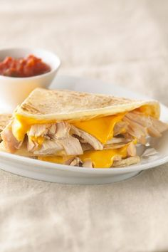 Cheesy Chicken Quesadillas – Get out of your plain-Jane sandwich recipe rut and treat yourself to this cheesy chicken quesadilla dish for one. Cut into wedges, serve with salsa and enjoy! Ready in under 10 minutes.
