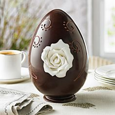 Dark Chocolate Yorkshire White Rose Easter Egg | Bringing together the skills of our chocolatiers and our cake decorating experts, this handmade Swiss Grand Cru dark chocolate egg is inset with an exquisitely delicate white Yorkshire rose, hand-crafted from sugar paste.