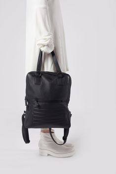 "Black minimal, two in one, unisex backpack-rucksack. It's divided into two separate sections. 100% Italian leather, perfectly fits 15"" Macbook, made in Europe."