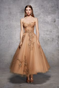 Strapless tulle tea length A-line gown with draped bodice, gold metallic outlined wheat and leaf threadwork and scattered 2 cut beading.