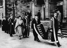 1949: PRINCESS HONORS Prince Philip, who was appointed Chancellor of the University of Wales, presents an honorary diploma in musicology to his wife, Princess Elizabeth.