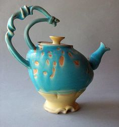 Wish I knew the artist! Nice teapot. Always attracted to teal, aqua, turquoise... cool shape & handle.