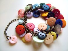 button-y bracelet  I'm not big into buttons- but I like this. All the colors are awesome- it would be sweet to have a funky fun bracelet like this