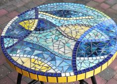 This stylish mosaic table is made of hand cutted stained glass pieces, glass tiles and glazed ceramic tiles.    Measurements:  height: 58 cm / ~23  diameter: 37 cm / 14,6