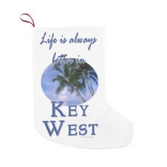 Funny Life Is Always Better In Key West Beach V Small Christmas Stocking Life is always better in Key West - the beach, relaxed lifestyle, the parties and Duval street! This tropical souvenir logo style design features landscape nature travel photography of a gorgeous beach with a blue sky in the background and palm trees in the foreground. This photo was taken in Key West, Florida USA. Great gift for a beach lover. #keywest #florida #souvenir #gift