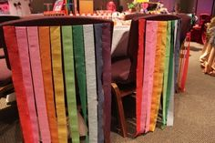 Chair back covers with rainbow colored crepe paper
