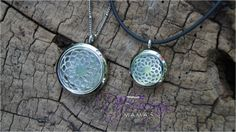 """These beautiful lockets are specifically designed to gently diffuse your favorite essential oils throughout the day and night.  Picture shown with large (30mm) and small (20mm) necklaces.   Includes: one highly durable stainless steel locket, chain and 2 highly absorbent, washable, and interchangeable pads (1 white and 1 black). The large locket includes a stainless steel adjustable beaded chain (approx. 17-1/2 to 19-1/2"""") and the small locket includes a black rubber necklace (approx. 16"""")."""