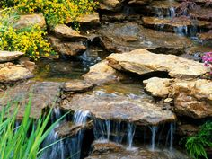 Creating a naturalistic stream and waterfall adds movement, noise and wildlife to the backyard landscape that will be enjoyed by the entire family. Ponds Backyard, Backyard Landscaping, Landscaping Ideas, Backyard Ideas, Backyard Waterfalls, Garden Ponds, Koi Ponds, Water Features In The Garden, Garden Features