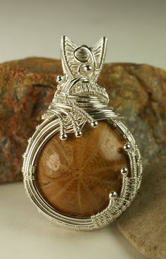Wire Woven Fine Silver Pendant with Seabiscuit Fossil. $257.00, via Etsy.