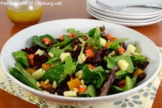 Roasted Carrot and Butternut Squash Salad with Mixed Greens, Extra Sharp Cheddar, and Pinenuts