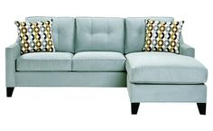 Minimalist Sofa With Two Blue Pillows Spotted On The Sofa, The Sofa Can Also Be Used For Bedding