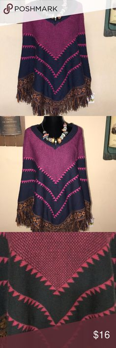 Beautiful multicolored Poncho with sleeves Beautiful multicolored Poncho  with sleeves gently used Fastastic Fawn Sweaters Shrugs & Ponchos