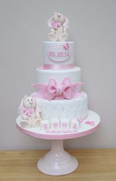 A three tiered Christening Cake complete with quilted effect and a sugar bow. Baby Girl Christening Cake, Baby Girl Cakes, Baptism Cakes, Torta Baby Shower, Cakes To Make, Fancy Cakes, Fondant Cakes, Cupcake Cakes, Bolo Minnie