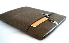 Handmade to order and shipped from California. A padded laptop sleeve made with a brown herringbone fabric with front pocket, 6mm thick foam