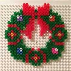 Xmas wreath Christmas deco christmas wreath perler beads hanger beads – All About Diy and Craft Melty Bead Patterns, Pearler Bead Patterns, Perler Patterns, Beading Patterns, Quilt Patterns, Beaded Christmas Decorations, Christmas Perler Beads, Beaded Ornaments, Hama Beads Design