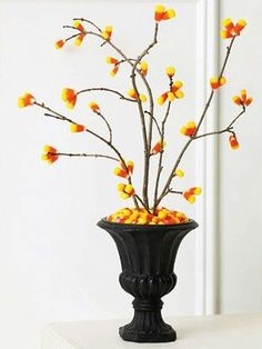 I love this idea just find some clean twigs from outside and hot glue candy corn to it. Im all about this kind of decor thats not so much scary halloween as it is fall fun. #Totalwine&more