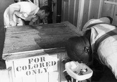 Plessy V Ferguson. A segregated drinking fountain in the South c.1960