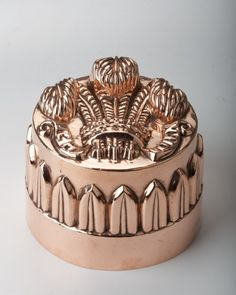 English, copper, rare pattern of The Prince Of Wales Feathers, unusual in that there is decoration on the base of the mould as well. 5.5″dia., 4.5″H circa 1850