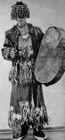 A Yakut shaman from the district of Verchne-Kolymsk. Note the fringe or veil obscuring the shaman's eyes. 