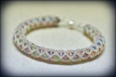 Ada finished her diamond mine bracelet that she started in last month's bead treat! It's her first seed beading project ever!  Great job! whoo hoo!  http://www.thebeadgallery.com/4-workshops/diamond-mine.html