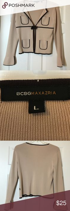 BCBGMaxAzaria sweater vest size Large This adorable fine gauge sweater vest comes in a camel/tan color with chocolate brown knit trim. It features unique sleeves, 4 small pockets - 2 on each side, and a hook & eye closure covered by a brown knit bow. Very comfortable and in EUC BCBGMaxAzria Sweaters Cardigans
