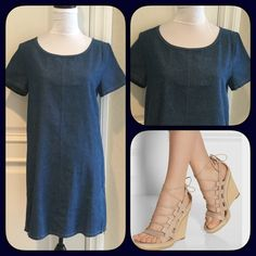 """""""Just In"""" Denim Shift Dress Cute denim shift dress. Dress as back zipper and two side zippers that can be unzipped. Measures approximately 35"""" long, bust 19"""" across lying flat. Back zipper 7"""", side zippers 8"""". Material 100% cotton. Cute with any color shoes from flats, heels to boots. Ad a belt or a scarf for a different look. Size Medium. NWT. Loveriche Dresses"""