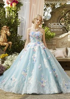Praise Wedding: This baby blue ball gown from Nicole collection featuring pastel flowers is utterly romantic! Fairytale Dress, Fairy Dress, Princess Fairytale, Blue Ball Gowns, Ball Gown Dresses, Wedding Dress Patterns, Colored Wedding Dresses, Quinceanera Dresses, Beautiful Gowns