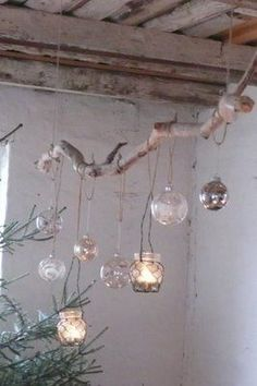 Christmas bulbs with candles or lights. ...I love the twine and branch.  Awesome outdoor atmosphere
