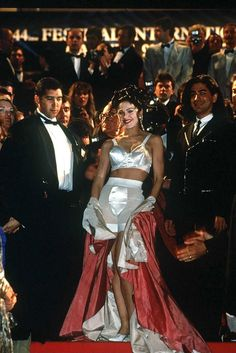See All of Madonna's Most Iconic Looks: At the Cannes premiere of Truth or Dare, the 1991 documentary about her Blond Ambition tour. She appeared wrapped in a silk sheet and later dropped it to reveal her cone bra and underwear.