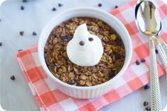 baked pumpkin chocolate chip oatmeal sweetened with coconut sugar and topped with greek yogurt ghosts