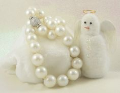 Huge white South Sea pearls finished with a diamond clasp are classically beautiful.