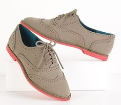 Oxfords are a classic and they are a popular shoe today. They modified the shoe just a little bit with a pop of color to make it modern.