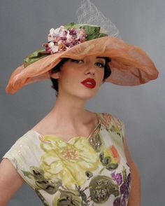 Louise Green 1950s vintage inspired fashion: hat (millinery) with wide brim and flower decoration, net.
