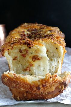 Bacon and Cheddar Pull Apart Bread. Soft and chewy pull apart bread loaded with extra sharp cheddar cheese and crispy bacon!