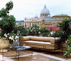 Step 1:  Try to find a location for your seating area with a tolerable view: Rooftop garden in Rome