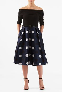 Make the most of the seventies trend in our flattering mixed media dress with a ruched pleat fold-over off-the-shoulder cotton knit bodice and a polka dot print dupioni box-pleat skirt.