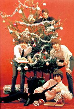Photo of BEATLES; The Beatles at Christmas, clockwise from left - Paul McCartney, Ringo Starr, John Lennon and George Harrison