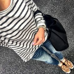 IG @mrscasual <click through to shop this look> Nordstrom striped sweatshirt. Vigoss destroyed skinny jeans. Steve madden eccentric leopard slip on sneakers. Black tote bag.