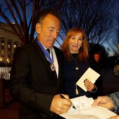 Bruce Springsteen signing autographs for fans outside the White House after receiving the Presidential Medal of Honor on November 22, 2016.