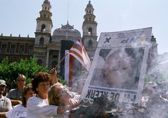 Far right-wingers and Conservative Party supporters burn an election poster with President de Klerk's portrait, March, 26, 1994, at a rally held by the Conservative Party in Pretoria. The CP is demanding their own homeland and declared Pretoria their capital. (AP Photo/Joao Silva).