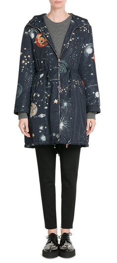 Valentino lends a playful twist to an outerwear essential, printing this lightweight parka silhouette with a whimsical constellation print. The navy base anchors the multicolored finish, while a mid-thigh length and high neck keeps it super practical #Stylebop