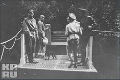 Nicholas, Olga, Anastasia, and Alexei with Tatiana's dog Ortipo in the Alexander Palace Park, June 1917