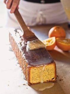 Almond-Orange Pound Cake 3/4 c cake flour 1/2 t bak powder pinch salt 5 lg eggs 1 t vanilla 7 oz almond paste 1 c sugar 1 c butter 2 t orange zest 1 t poppy seeds Glaze: 1/4 c lemon juice 3 T orange juice 3/4 c sugar