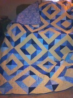 I made this quilt as a college graduation gift for my cousin's daughter. Hand pieced and hand quilted, using my sewing machine only for the binding. It's a King-sized quilt and took me a year to complete.